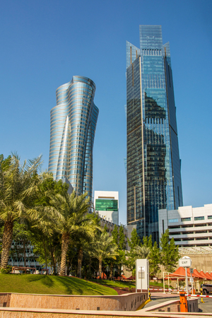 Close up view of modern skyscrapers with glass facade financial and business center in Doha, Qatar against clear blue sky