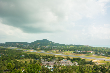 Airstrip at tropical island Koh Samui under clouds, aerial view. Thailand panorama viewpoint view
