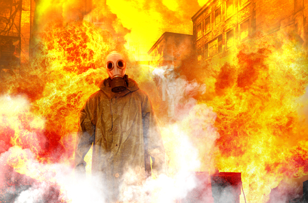 Man in gas mask and USSR cloak for chemical protection surrounded by smoke in fireplace, danger, Armageddon concept