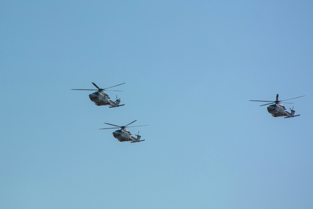 Three helicopters AW139 in the air flying together during airshow in Qatar