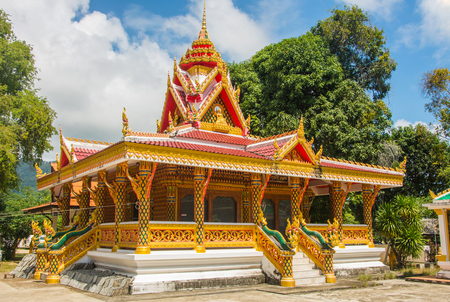 Thailand, Koh Samui, Wat Sumret among the trees under blue sky