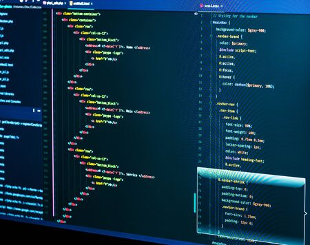 IT coding on monitor screen. HTML markup language closeup. Programming code. Closeup of Script, CSS and HTML code