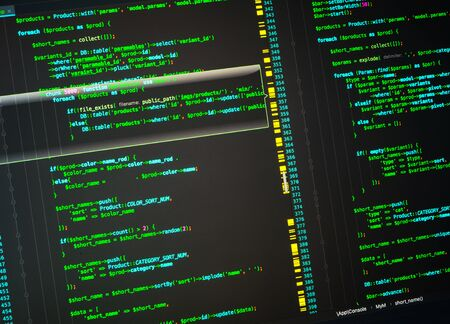 Php developing of the site in the code editor. Green code on black background Banco de Imagens