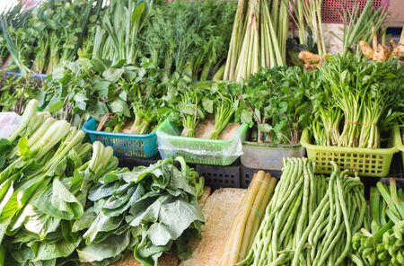 Greengrocery on sale at thai market - Chinese cabbage, mint, spinach, basil, Chinese Mustard Green, Eringium, black Eyed Peas Stok Fotoğraf