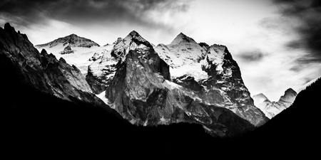 Dramatic mountain range with snow on peaks - Black and white Reklamní fotografie
