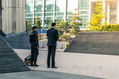 Police with explosion detection dog stationed in Shenzhen, China - April 2018