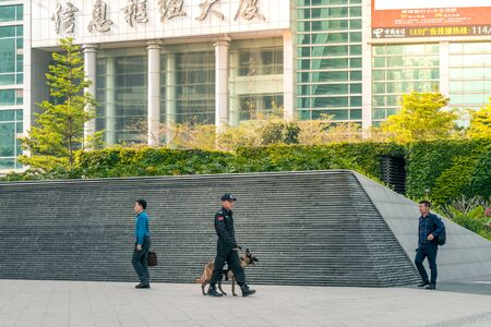 Police Officer With Explosive Detection Dog in Shenzhen, China - April 2018