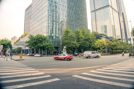 Intersection with cars and crosswalks in downtown Shenzhen, China - April 2018
