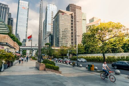 Downtown scenery with buildings and people in Shenzhen, China - April 2018