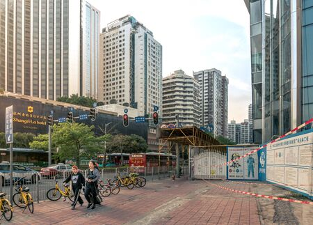 Scenery of people and buildings in Shenzhen, China - April 2018