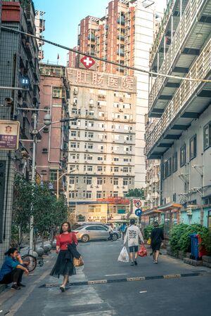 People walking in side street in Shenzhen, China - April 2018 Sajtókép