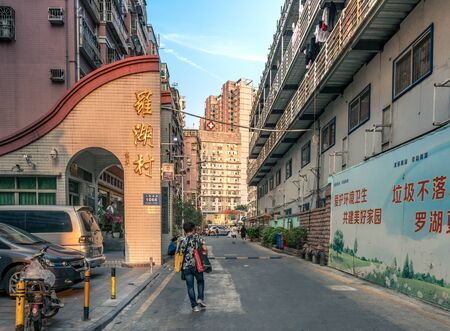 Alleyway with people walking in downtown Shenzhen, China - April 2018 Redakční