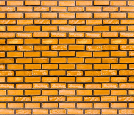 Yellow brick wall for texture or background. Banco de Imagens