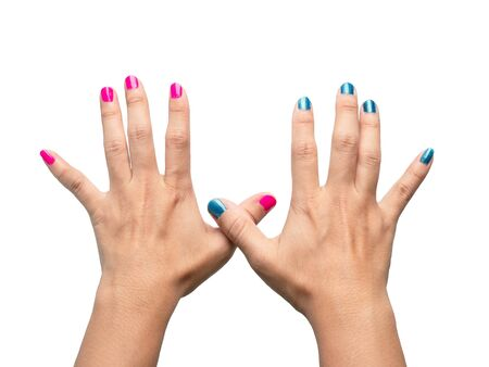 Close-up Hands of beautiful female with paint pink and blue nails on white background. 写真素材 - 133669424