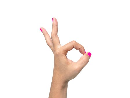 Close-up of a woman's hand showing OK sign with a pink nail polish isolated on a white background. 写真素材 - 133669425