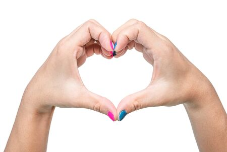 Close-up of a woman's hand showing heart sign with a pink and blue nail polish isolated on a white background. 写真素材 - 133669447