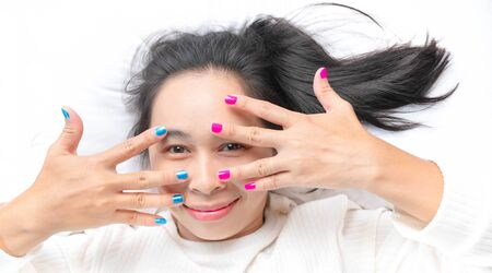 Close-up of female showing hands paint nail varnish with smiley face, self made manicure at home. 写真素材 - 133669451