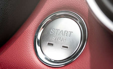 The button to start the engine of a car.