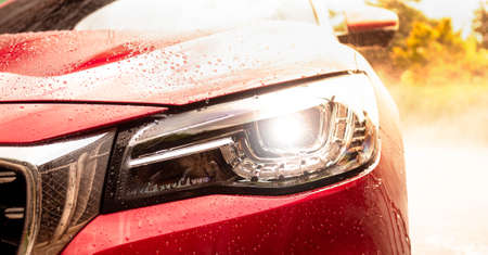 Close-up of front headlight lamp of modern car.