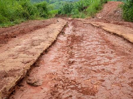 Gravel road with mud in countryside. Zdjęcie Seryjne
