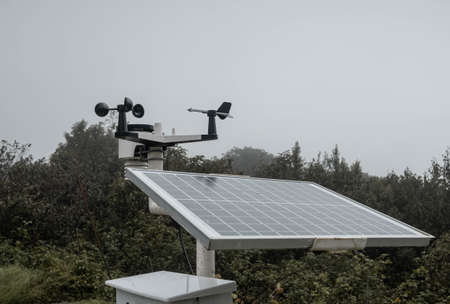The Meteorological instrument to measure the wind speed, temperature and humidity and solar cell system on peak of Inthanon mountain.