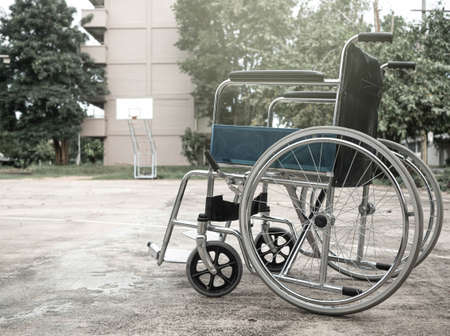 Empty wheelchair parked in the park. Zdjęcie Seryjne
