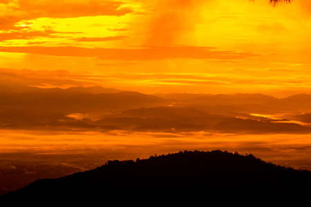 Beautiful landscape at sunset sky with clouds on peak of mountains.