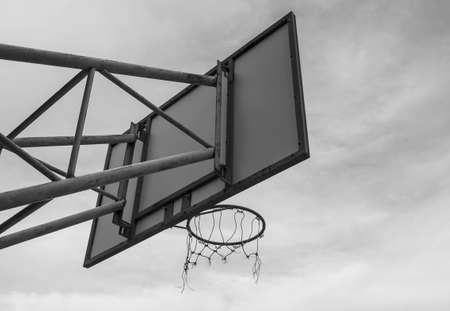 The back image of the basketball board hoop with the loop on the sky background. Black and white style tone. Zdjęcie Seryjne