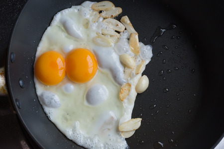 sunny side: Fried twin egg and slide galic (Sunny side up) Stock Photo