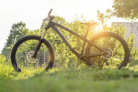Modern bicycle. Black mountain bike at sunset. Trail bike. Hardtail enduro mtb.
