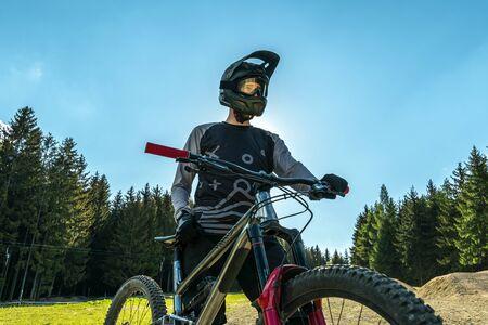 Mountain biker with bike.