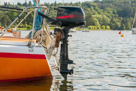 Yacht on the lake. Ship propeller. Outboard engine. Banco de Imagens