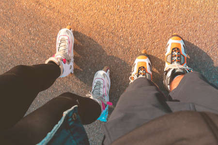 Top view of legs with inline skates. Boy and girl on roller skates. Place for text.