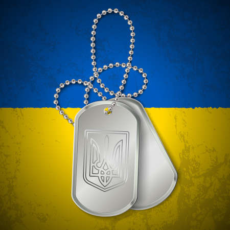 Military dog tag with national symbols of Ukraine on dirty flag. Ukraine conflict.