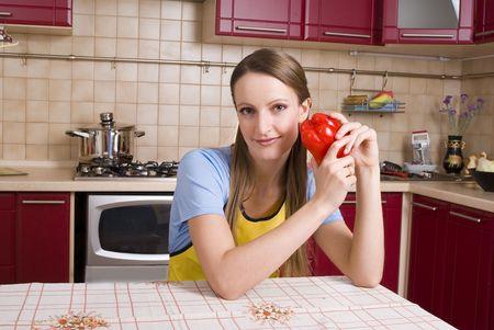 Two Women Preparing Dinner in the kitchen photo