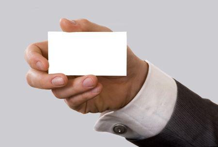実業家は彼の名刺を示します。フィールドの浅い深さ - 指やカードに焦点を当てる。ちょうどあなたのテキストを追加できます。