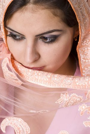 Portrait of a beautiful Muslim woman with brown eyes photo
