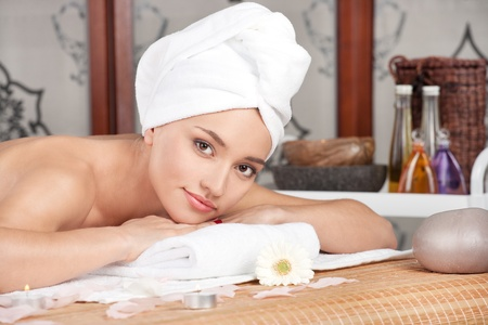 Beautiful woman having relax in spa salon photo