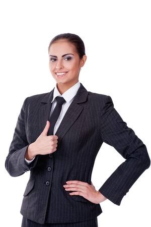 Young sucsessful businesswoman looking on camera and smiling photo
