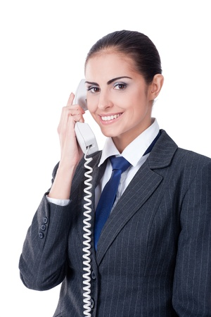 Young businesswoman speaking on phone, smiling, isolated on white Stock Photo - 11432259