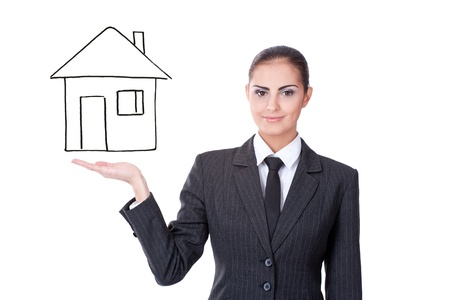 young businesswoman with virtual house on white background photo