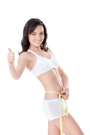 muscle belly: Woman measuring waist of perfect body. weight loss concept
