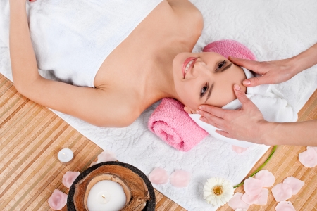 Beautiful woman having relax in spa salon