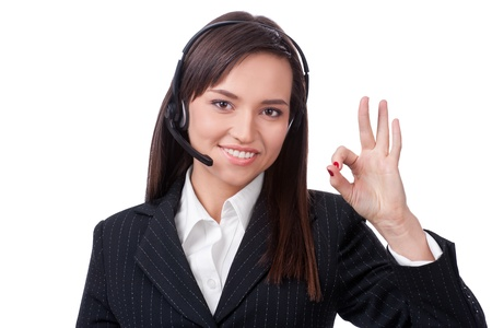 hands free device: Woman Operator of call center with headset Stock Photo