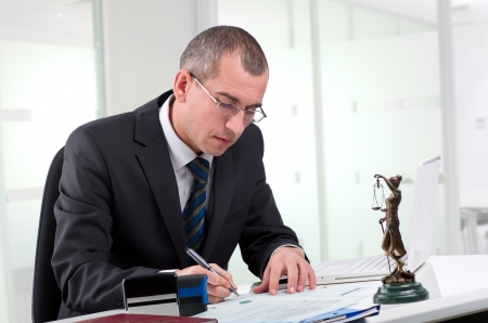Lawyer or notary public at contemporary office photo