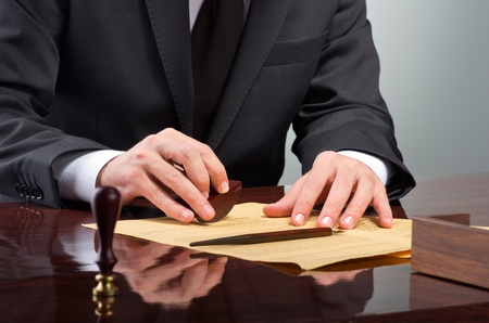 notary: Businessman notarize testament at notary public office