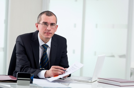 law business: Lawyer or notary public on his workplace signing contract