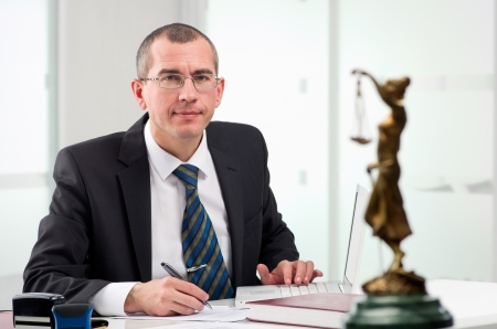 computer law: Lawyer or notary public at contemporary office Stock Photo