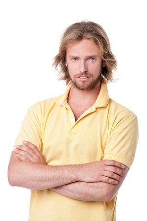 交差腕を持つハンサムな若い男の肖像画 写真素材