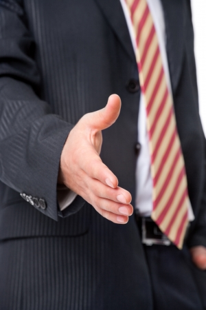 Young businessman offering a handshake, close-up photo photo